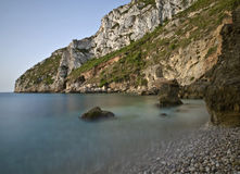 Beautiful Mediterranean Cove. Beautiful cove in Spain, with the morning light. Long time of exposure used to increase the sense of calm on the water Royalty Free Stock Photos