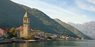 Beautiful Mediterranean landscape. Montenegro, Bay of Kotor. View of ancient town of Stoliv and Name of Mary Church stock photography