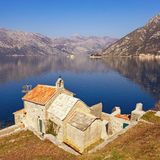 Beautiful Mediterranean landscape. Montenegro. View of Bay of Kotor, Church of Our Lady of the Angels and two small islands. Beautiful Mediterranean landscape royalty free stock photos
