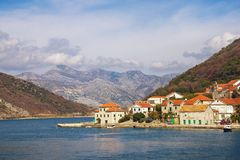 Beautiful Mediterranean landscape. Small seaside village at the foot of the mountains. Montenegro, Bay of Kotor, Lepetane village. Beautiful Mediterranean stock photo