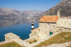 Beautiful Mediterranean landscape on sunny spring day. Montenegro. View of Bay of Kotor and Church of Our Lady of Angels. Beautiful Mediterranean landscape on royalty free stock images