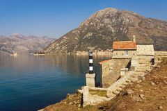 Beautiful Mediterranean landscape on sunny spring day. Montenegro. View of Kotor Bay and ancient Church of Our Lady of Angels. Beautiful Mediterranean  landscape stock photo