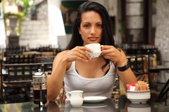 Beautiful mediterranean woman drinking coffee Stock Photo