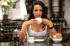 Beautiful Mediterranean Woman Drinking Coffee Stock Photo