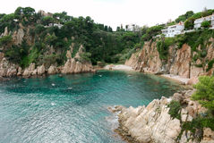 Beautiful mediterranian bay. With green water on the Costa-Brava royalty free stock photography