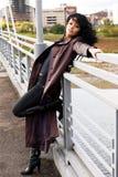 Beautiful melancholic woman on the bridge Stock Photos