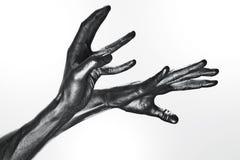 Beautiful men metal hands with long fingers Stock Image