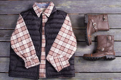 Beautiful men's checkered shirt with a waistcoat and leather boo Stock Photos