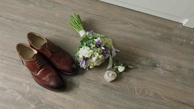 Beautiful men wedding accessories. Shoes, rings, bouquet, belt and tie.
