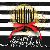 Beautiful menorah silhouette on black and white striped background with golden glitter Royalty Free Stock Photo