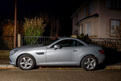 Beautiful Mercedes-Benz SLK roadster car parked in night city Royalty Free Stock Image