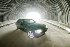 Beautiful Mercedes on the road in a tunnel Royalty Free Stock Photo
