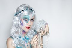 Beautiful mermaid girl in white wig stock image