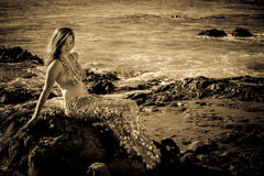 Beautiful Mermaid on Lava Rocks black and white image Royalty Free Stock Photos