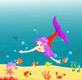 Beautiful mermaid Swimming Underwater with sea animals Stock Images