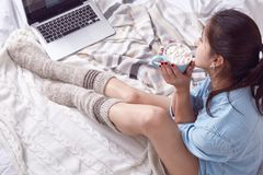 Beautiful Merry Christmas morning brunette woman drink sweet cup Stock Photos