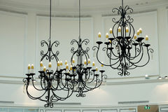 Beautiful metal chandelier in room Stock Photography