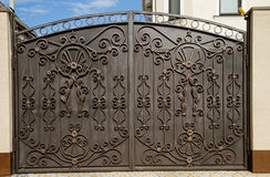 Beautiful metal gates at the cottage. Summer day Stock Images