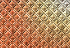 Beautiful metal pattern. On the wall of a building photographed close up Stock Photos