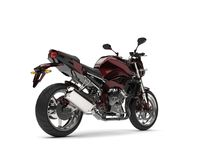 Beautiful metallic dark red modern sports motorcycle - tail view. Isolated on white background Stock Photography