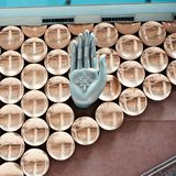 Stylish metallic hand sign of an interior decoration wall unique photo. A beautiful metallic hand signs of an interior wall decoration of a restaurant isolated stock photos