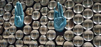 Stylish metallic hand sign of an interior decoration wall unique photo. A beautiful metallic hand signs of an interior wall decoration of a restaurant isolated stock photography