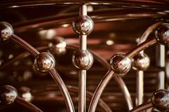 Stylish shiny metallic object background photograph. The beautiful metallic pipes stylish object unique background photograph royalty free stock image