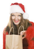 Beautiful mid adult woman in Christmas Santa Claus red hat with Royalty Free Stock Images