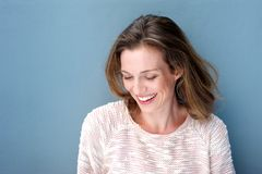 Beautiful mid adult woman laughing with sweater Royalty Free Stock Photos