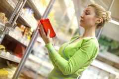 Beautiful mid adult woman shopping  in a supermarket Stock Photo