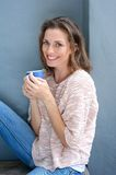 Beautiful mid adult woman smiling with cup of coffee Stock Photo