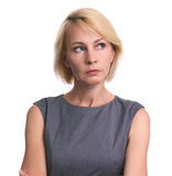 Beautiful mid aged business woman looking away. Having doubtful. Isolated stock photography