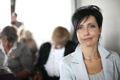 Beautiful mid-aged woman portrait at conference hall Stock Photo
