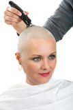 Beautiful middle age woman cancer patient shaving hair Stock Image