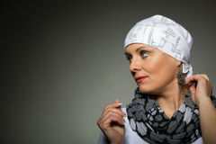Beautiful middle age woman cancer patient wearing headscarf stock photography