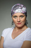 Beautiful middle age woman cancer patient wearing headscarf Stock Image