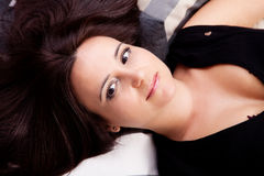 Beautiful middle-age woman lying Royalty Free Stock Image