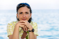 Beautiful middle age woman portrait on beach Stock Photography