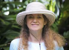 A Beautiful Middle Age Woman in a Sun Hat. A Beautiful Middle-Aged Woman in a Sun Hat Royalty Free Stock Photos