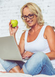 Beautiful middle aged businesswoman Stock Photos