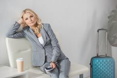 Businesswoman waiting for trip. Beautiful middle aged businesswoman waiting for trip Stock Photography