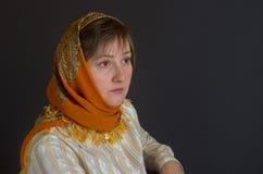 Beautiful middle-aged Caucasian woman wearing shawl Stock Photo