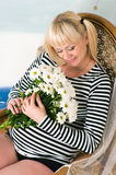 Beautiful middle aged pregnant female Stock Photo