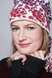 Beautiful middle-aged woman. Beautiful happy smiling middle-aged woman in knitted hat and pullover Stock Images