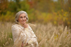 Beautiful middle-aged woman in autumn park Royalty Free Stock Image
