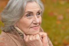 Beautiful middle-aged woman in autumn park Royalty Free Stock Photos