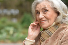 Beautiful middle-aged woman in autumn park Royalty Free Stock Photo