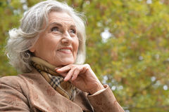 Beautiful middle-aged woman in autumn park Stock Image