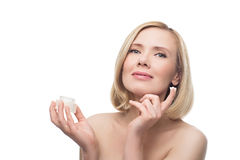 Beautiful middle aged woman with cream Stock Image