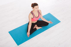 Beautiful Middle Aged Woman Doing Yoga Indoors Horizontally Top View Royalty Free Stock